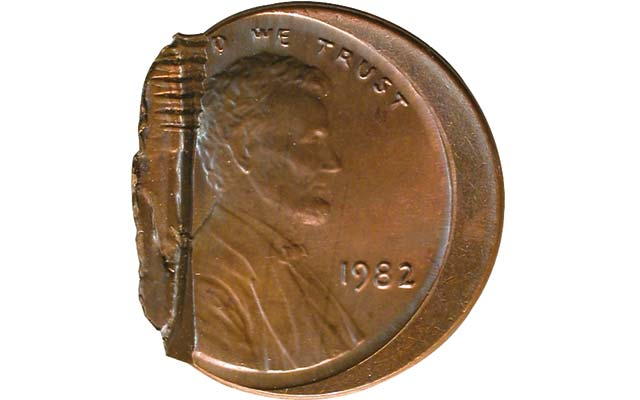 Five-cent coin cut in two by intrusive machine part or piece of hardware: Collectors' Clearinghouse