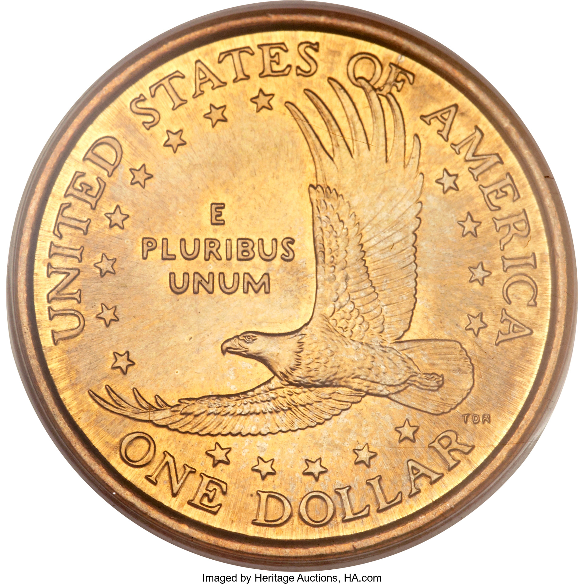 Appearing on the reverse of the manganese brass coin is what one would expect to find: the Soaring Eagle reverse of the just-released golden Sacagawea dollar. But the other side isn't Sacagawea. It's interesting to speculate if any more or out there, lying in unsearched rolls or bags of the millennium dollars.