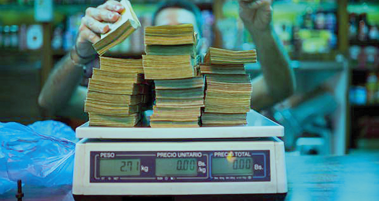 Venezuelan 100-bolivar notes being weighed