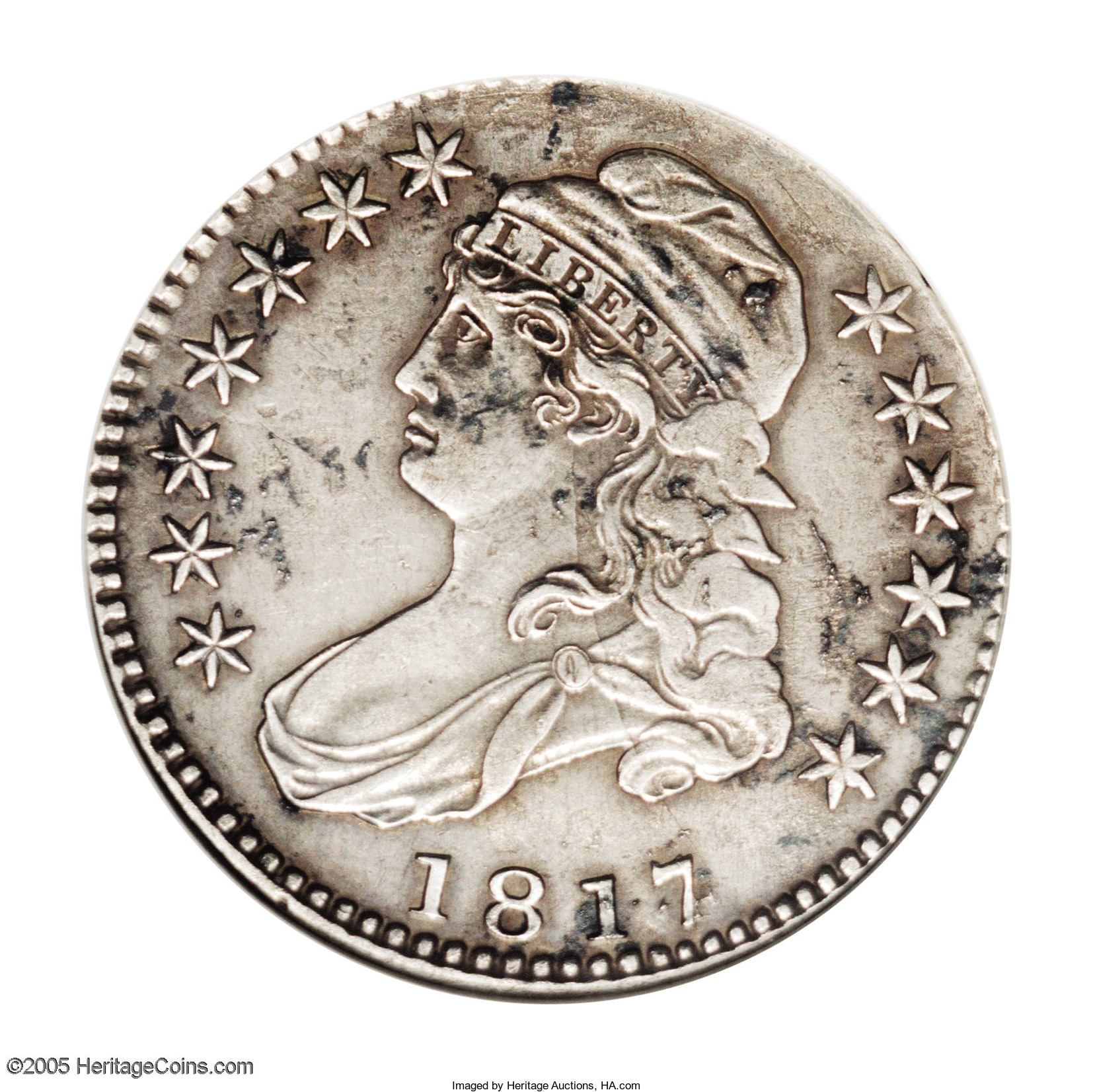 This eighth known specimen of the ultra-rare 1817/4 half dollar was found in a load of fill dirt.