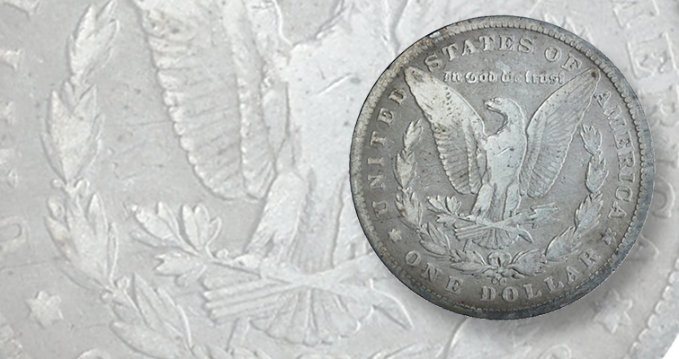 This 1890-CC Morgan, Tailbar dollar with a deep die gouge demands a premium.