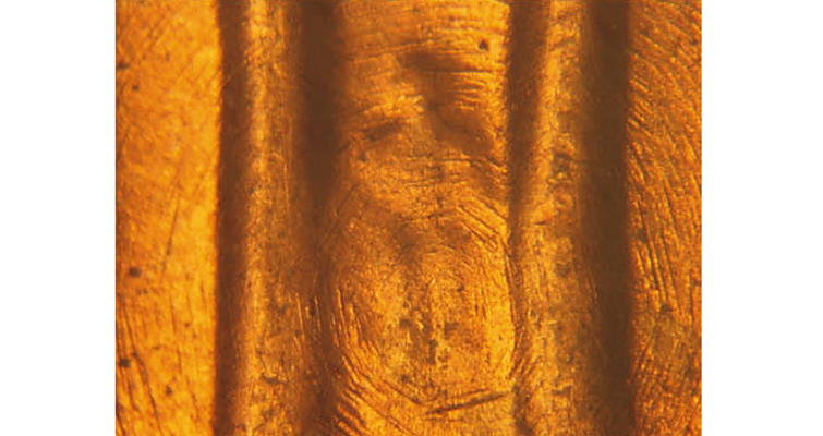 1982 Lincoln cent with die scratches