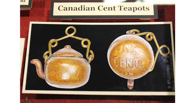 One of the most intriguing display exhibit entries at the 2016 ANA convention in Anaheim featured cent coins turned into objets d'art, prisoner folk art. Inmates at ta Canadian prison created these miniature teapots from Canadian cents. The teapot at right is positioned to show the coin's ONE CENT legend preserved on the tiny teapot bottom.