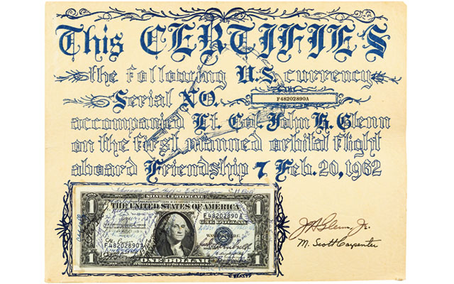 A Series 1957A $1 silver certificate flown in outer space will be offered in Nov. 12 sale
