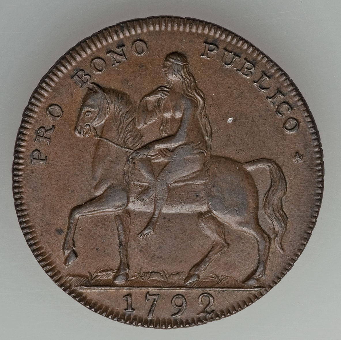 Privately minted 1792-1794 halfpenny token issued during Great Britain's Condor token craze depicts the legendary Lady Godiva and carries the legend PRO BONO PUBLICO as do many Condor tokens, meaning