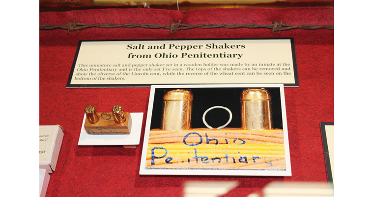 Among the intriguing display exhibit entries at the 2016 ANA convention in Anaheim were these cent coins turned into objets d'art, prisoner folk art. Inmates at the Ohio Penitentiary turned a pair of Wheat cents into this pair of salt and pepper shakers.