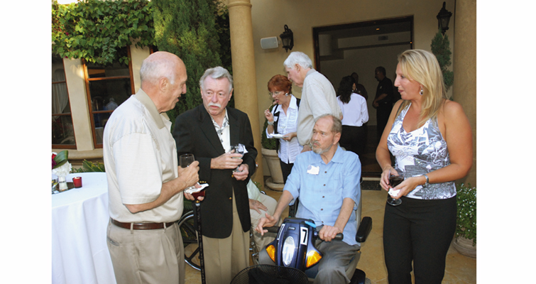 Dan Holmes, second from right, and his daughter, Anne, share conversation Sept. 5, 2009, with two well-known large cent collectors, Wes Rasmussen, far left, and Walt Husak.
