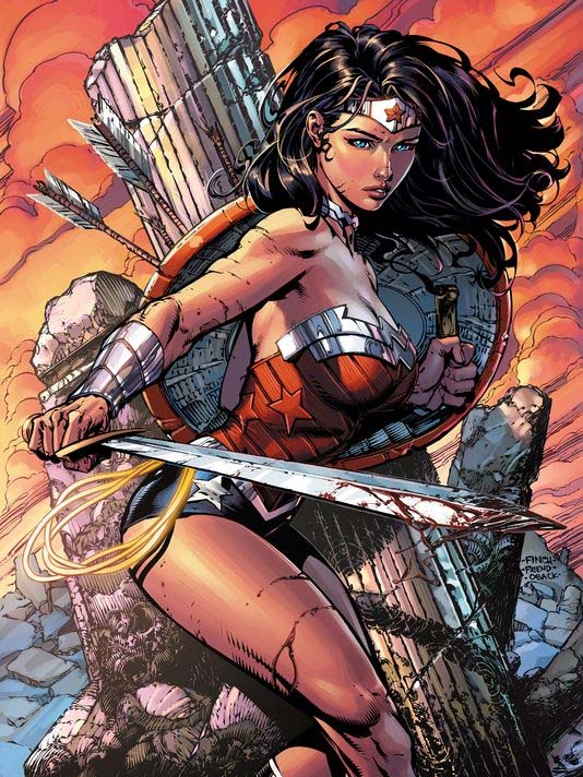 The D.C. Comics character Wonder Woman is often depicted as an Amazonian warrior, complete with sword and shield. Was she inspiration (even in part) for a proposed design for the 2015 High Relief gold coin? Probably not, but the resemblances are interesting.