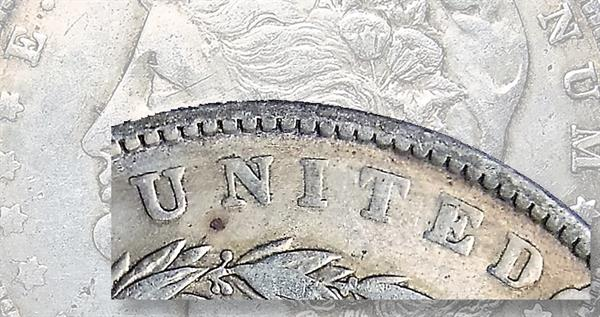 counterfeit-1883-cc-morgan-dollar-lead