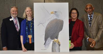 ANA officials and artist Emily Damstra