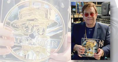 Elton John with medallion
