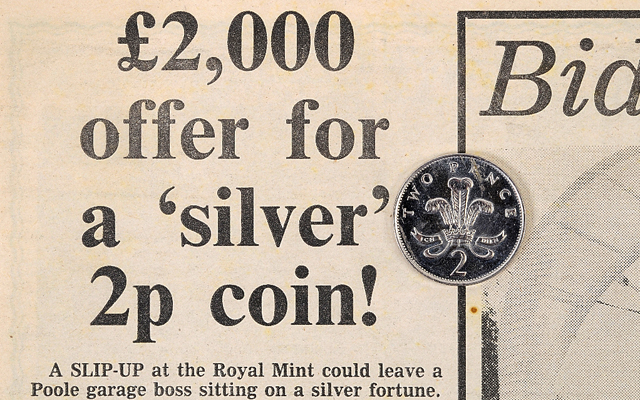 error-coin-on-newspaper-clipping