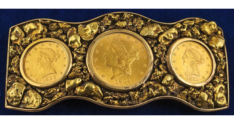 Belt buckle emblazoned with gold coins, nuggets crossing the auction block
