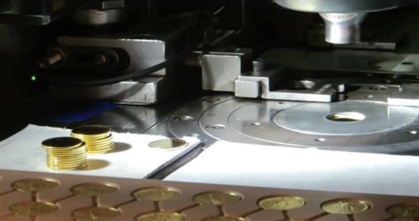 gold-standing-liberty-quarter-being-struck-west-point-mint