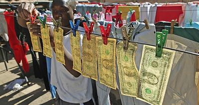 U.S. dollars being repaired in Zimbabwe