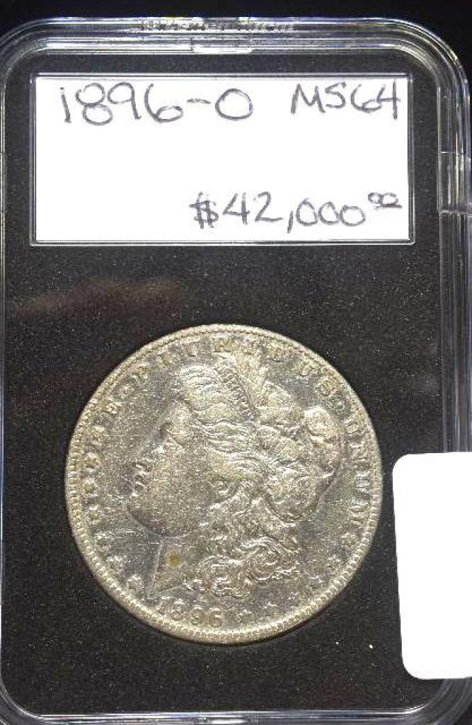This corroded presumed Morgan dollar is certainly nowhere near any Mint State grade and worth silver melt at best, a far cry from $42,000.