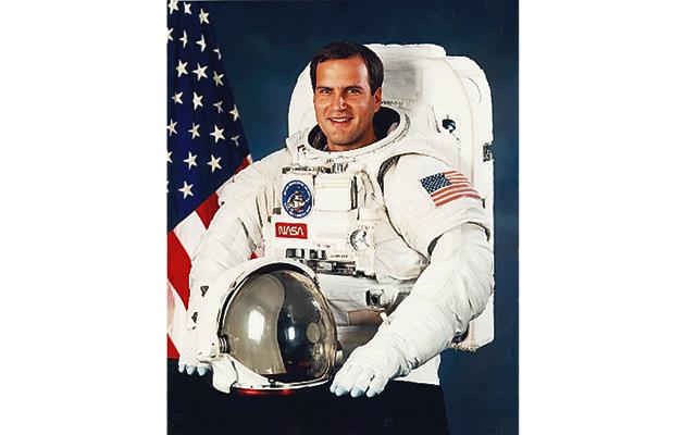 Royal Australian Mint hosts NASA astronaut for coin striking