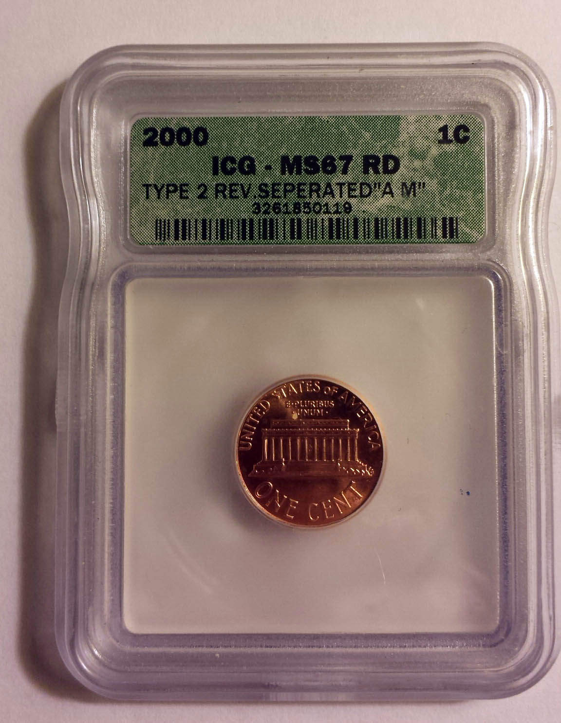 "The coin looks perfectly graded and attributed, but ""seperated"" is a misspelling."