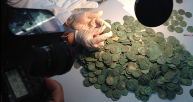 Archaeologists examine Roman coins in Spanish hoard