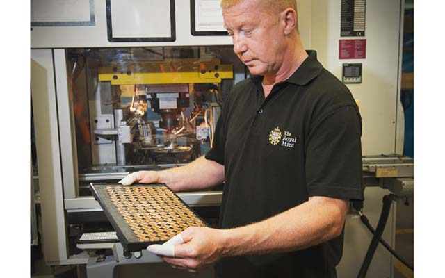 the-royal-mint-press-setter-paul-collier-checking-gold-sovereign-bullion-coins
