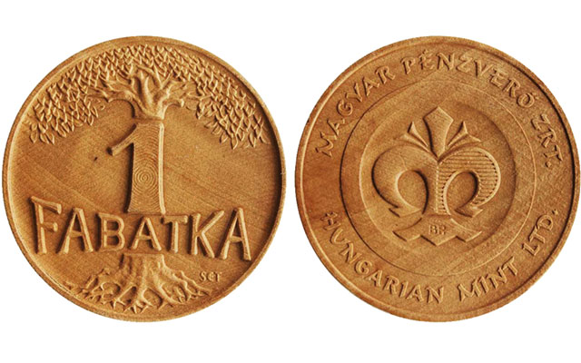 Hungarian Mint strikes wooden medal on coinage press